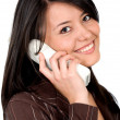 Casual girl talking on the phone — Stockfoto