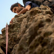 Climber on a rock - Stock Photo
