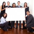 Office team holding a cardboard — Stock Photo #7774502