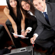 Stock Photo: Business team in an office laptop