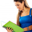 College student reading a green notebook — Stock Photo