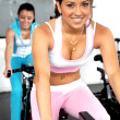 Girls cycling at gym — Stock Photo #7774578