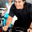 Mcycling at gym — Stock Photo #7774579