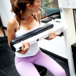 Stock Photo: Girl exercising at the gym