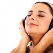 Listening music on headphones - Stock Photo