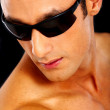 Fashion man wearing sunglasses — Stock Photo
