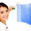 Stock Photo: Woman painting a wall