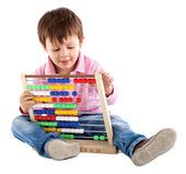 Kid with an abacus — Stock Photo