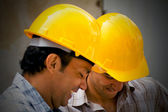 Construction workers smiling — Stock Photo