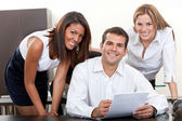 Business man with assistants — Stock Photo