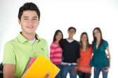 Male student with a group — Stock Photo