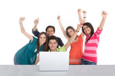 Excited group with a laptop — Stock Photo