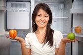 Woman taking fruits from the fridge — Stock Photo