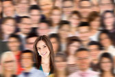 Woman standing out from a crowd — Stock Photo