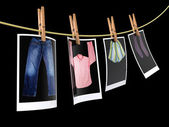 Clothes pin holding photographs — Stock Photo