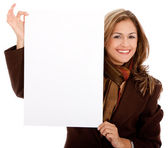 Business woman with a banner — Stock Photo