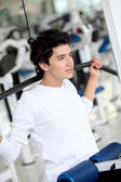 Man at the gym exercising — Stock Photo