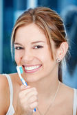 Woman holding a toothbrush — Stock Photo
