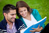 Couple of students outdoors — Stock Photo