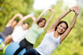 Pilates class outdoors — Stock Photo
