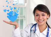 Doctor holding hearts — Stock Photo