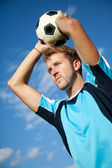 Footballer doing a throw in — Stock Photo