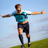 Footballer celebrating — Stock Photo