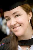 Female graduating at university — Stock Photo