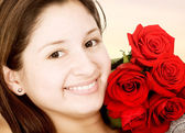 Beautiful girl with red roses — Stock Photo