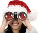 ženské santa s dalekohledem — Stock fotografie