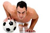 Fit man doing pushups — Stock Photo