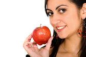 Girl holding an apple — Stock Photo