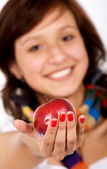 Beautiful girl holding an apple — Stock Photo