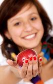 Beautiful girl holding an apple — Stock Photo