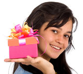 Casual girl holding a gift — Stock Photo