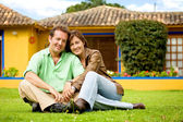 Happy couple outside their home — Stock Photo