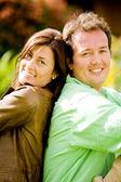 Happy couple portrait - back to back — Stock Photo