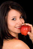 Girl eating an apple — Stock Photo