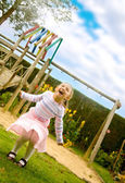 Girl having fun at a playground — Stock Photo