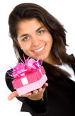 Business girl offering a gift — Stock Photo