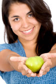 Girl offering a green apple — Stock Photo