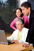 Family on a laptop — Stock Photo