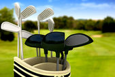 Golf clubs on a course — Stock Photo