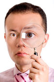 Man with magnifying glass — Stock Photo