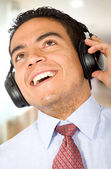 Business man listening to music — Stock Photo