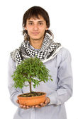 Male ecologist holding a tree — Stock Photo