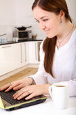 Casual girl browsing the internet at home — Stock Photo