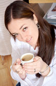 Home lifestyle - girl drinking coffee — Stock Photo
