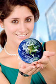 Business woman holding a globe — Stock Photo
