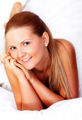 Casual woman portrait in her bed — Stock Photo